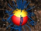 Žlutě: hory na magnetických pólech neutronové hvězdy (druhá, nacházející se na vzdáleném pólu, je očím prakticky skryta). Modře: siločáry magnetického pole.