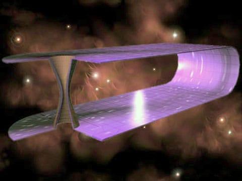 červí díra (anglicky Wormhole) - hypotetický tunel spojující dvě oblasti vesmírného času